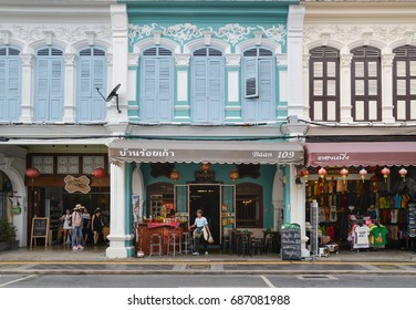 Phuket, Thailand - July 21, 2017: Local people and tourist are shopping along the street in Phuket old town area Phuket, Thailand.