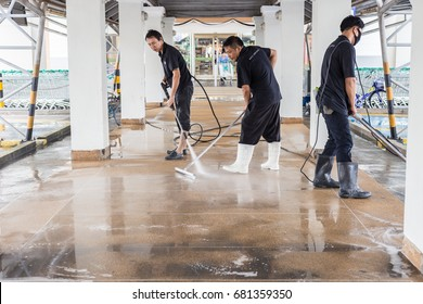 PHUKET, THAILAND - JULY 21 : An unidentified people cleaning sand wash exterior walkway using high jet water pressure washer and polishing machine on July 21, 2017 in Phuket, Thailand.