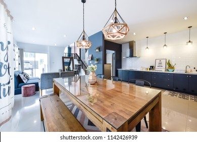 PHUKET, THAILAND - JULY 7 : Beautiful Modern dining room interior with kitchen zone at the home for a new family on JULY 7, 2018, in Phuket Thailand.