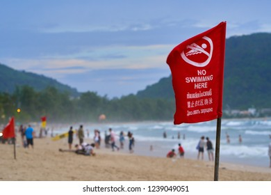 PHUKET, THAILAND - JULY 9, 2018: No Swimming sign on Patong Beach - the most known beach of Phuket.