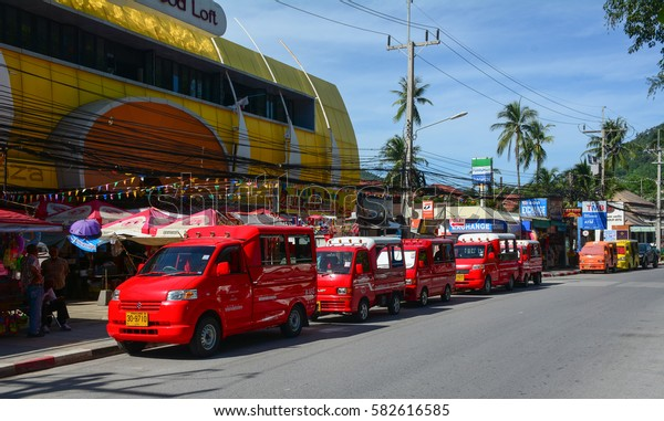 Phuket, Thailand - Jun 19, 2016. Many taxis (tuk tuk) parking on street in Phuket, Thailand. The island is Thailands largest at 48km in length and 21km at its widest.