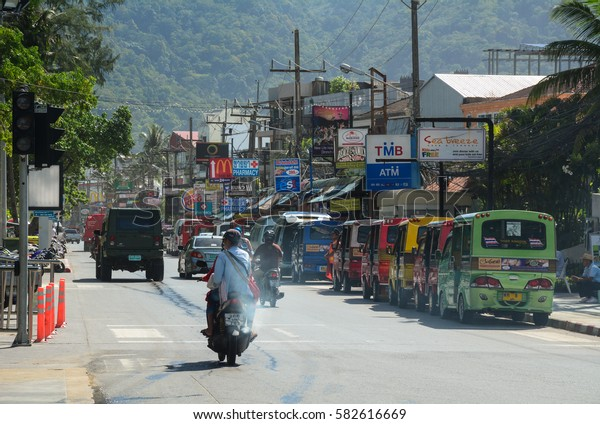 Phuket, Thailand - Jun 19, 2016. People ride scooters on street in Phuket, Thailand. The island is Thailands largest at 48km in length and 21km at its widest.