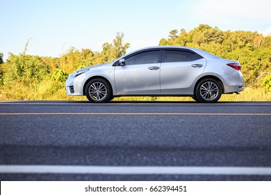 PHUKET, THAILAND - JUNE 16 : Toyota Corolla Altis parking on the asphalt road in Phuket on June 16, 2017. The official dealer of Toyota, who is the top market share for commercial car