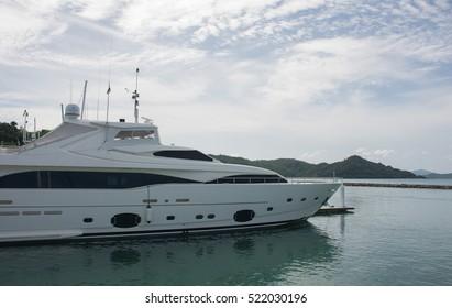 PHUKET THAILAND - JUNE 27,2016 : The luxury yachts are docked. in Ao Po Grand marina , luxury yachts and sailboats at AO PO GRAND MARINA 27,2016 at Ao Po, Paklok ,Phuket ,Thailand