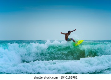 PHUKET, THAILAND -JUNE 3 : Unidentified man surfer surfs a big wave at Phuket Thailand on JUNE 3,2016.