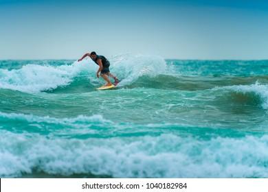 PHUKET, THAILAND -JUNE 3 : Unidentified man surfer surfs a big wave at Phuket Thailand on JUNE 3,2016.