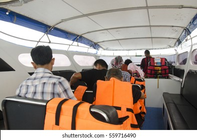 PHUKET, THAILAND - JUNE 6 : Thai people passengers and foreigner travelers wait and sit on boat at Bang Rong Pier at Phuket for go to Koh Yao Noi Island on June 6, 2016 in Phuket, Thailand