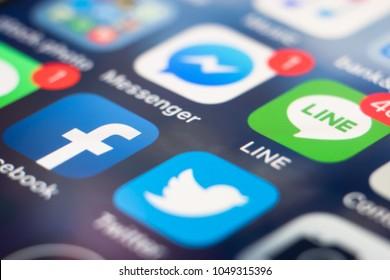 PHUKET, THAILAND - MAR 16, 2018: iphone home screen of social media app icon, facebook, line, messenger and twitter, macro shot
