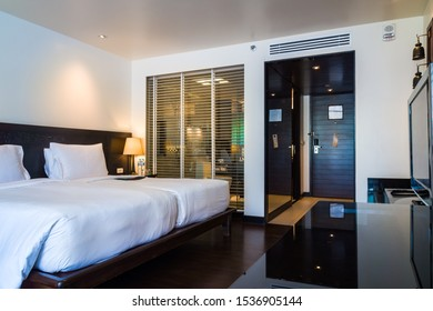 Phuket Thailand - Mar 23, 2017: Guest room with 2 Twin/Single Beds of Le Meridien Beach Resort, featuring services and facilities e.g. sexiest see-thru shower bathroom with retractable Venetian blind