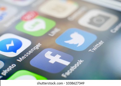 PHUKET, THAILAND - MAR 5, 2018: iphone home screen of social media app icon, facebook and twitter, selective focus