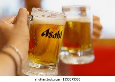 PHUKET, THAILAND - MAR 8, 2019: chilled asahi beer mug bottoms up, asahi is one of favorite japan beer