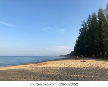 Phuket, Thailand - Mar 9, 2019 : Beautiful sands and blue sea and bright sky at Mai kao Beach.Mai Kao Beach in Phuket Thailand on summer vacation.Popular calm beach in Phuket.