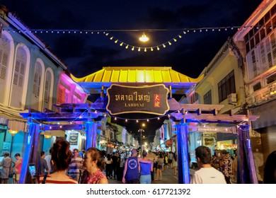 PHUKET, THAILAND March 26, 2017: Tourists shop at the old town night market (walking street) among old building Chino Portuguese style, street of Phuket town in Phuket, Thailand.