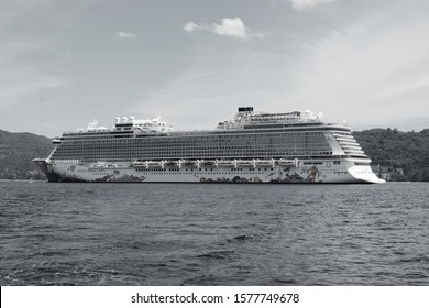 "PHUKET, THAILAND -MARCH 26.2019: View of the cruise ship ""Genting Dream"",  docked in Patong beach Phuket, Thailand."
