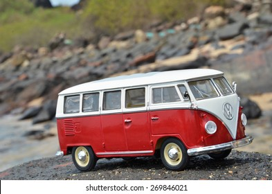 PHUKET, THAILAND - MARCH 27, 2015: Miniature VW Bulli 1962 on the rock. The cult car of the Hippie generation and it remained the status vehicle of the high wave surfers