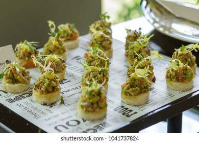 Phuket, Thailand – March 7, 2018: Tapas with an Asian twist isolated on food tags typography textured background served at coffee break in the hotel.