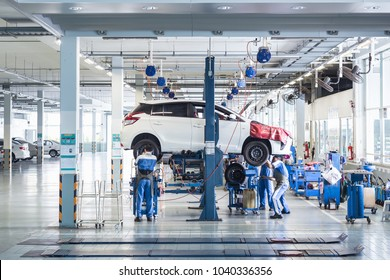PHUKET, THAILAND - MARCH 7 : Car technician repairing car in workshop service station in Phuket on March 7, 2018. The official dealer of Toyota, who is the top market share for commercial car