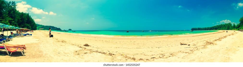 Phuket / Thailand, Mart 9, 2019:  Happy travel tourist enjoy summer vacation on tropical beach Phuket in Sirinat national park. Phuket, Thailand