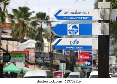 PHUKET, THAILAND - MAY 01, 2017 : Tsunami warning and evacuation signs by Patong beach in Phuket, Thailand.