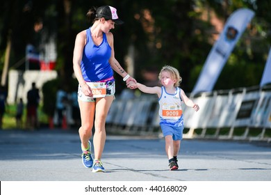 PHUKET, THAILAND - MAY 04: Unidentified mother with son run in a Kids' Run race during the Laguna Phuket International marathon at Laguna on May 04, 2016 in Phuket, Thailand.