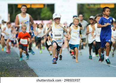 PHUKET, THAILAND - MAY 07: Unidentified children just after the start in a Kids' Run race during  the Laguna Phuket  International marathon at Laguna on May 07, 2015 in Phuket, Thailand.