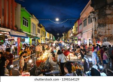 Phuket, Thailand - May 12, 2019: Many tourists are walking along the street at Lard Yai, Phuket weekend market, in Phuket old town area, Thailand.