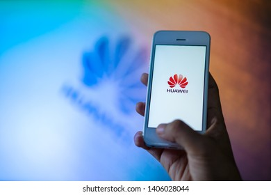 PHUKET, THAILAND - MAY 24, 2019: hand holding smartphone with screen of huawei logo, Google blocks Huawei's access to Android updates on may 20 and US delays Huawei ban for 90 days afterward
