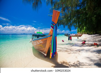 PHUKET, THAILAND - MAY 4:  View of Long tail speed boat with perfect blue sky on tropical summer beach, Andaman Sea on May 4, 2018 in Phuket, Thailand.