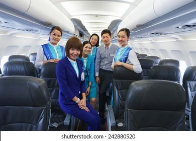 PHUKET, THAILAND - NOV 07: Bangkok Airways crew members on November 07, 2014. Bangkok Airways is a regional airline based in Bangkok. Its main base is Suvarnabhumi Airport, Bangkok
