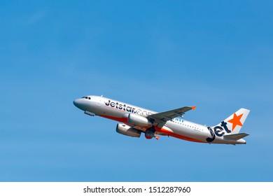 Phuket, Thailand - Nov 2014: Take off and landing of Jetstar Airbus A320, Phuket International airport. Civil aviation jetliner in Thai sky ready for landing. Australian Airlines silver star Airliner