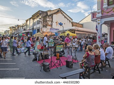 PHUKET, THAILAND NOVEMBER 01, 2015: Tourists shop at the old town night market (walking street) among old building Chino Portuguese style, street of Phuket town in Phuket, Thailand.