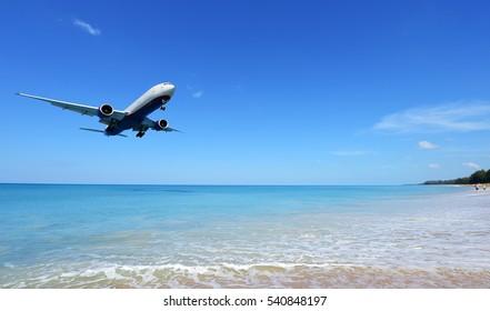 PHUKET, THAILAND - NOVEMBER 17 : The airplane landing at Phuket airport over the Mai Khao Beach on November17, 2016 in Phuket, Thailand.