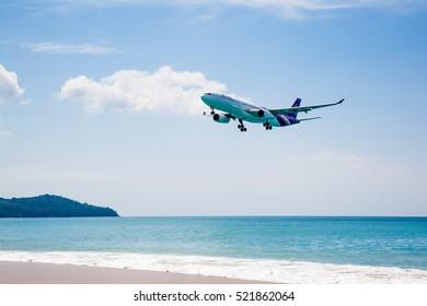 Phuket, Thailand - November 18,  2016: plane landing over the sea