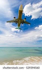 Phuket, Thailand - November 25,  2016: plane landing over the sea