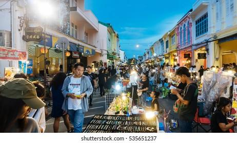 PHUKET, THAILAND NOVEMBER 27: Tourists enjoy shopping at the walking street among old building Chino Portuguese style on street of Phuket town, Thailand on November 27, 2016.