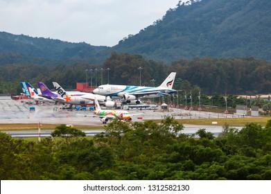 PHUKET, THAILAND - NOVEMBER 29, 2016: Airbus A319-132, HS-PPC of Bangkok Airways is landing and approach from the sea at Phuket International Airport