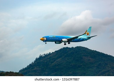 PHUKET, THAILAND - NOVEMBER 29, 2016: Boeing 737-8AS, HS-DBD of Nokair flies in the sky over the mountains at Phuket International Airport