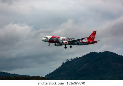 PHUKET, THAILAND - NOVEMBER 29, 2016: Airbus A320-216, HS-ABC of AirAsia (Amazing Thailand Livery) flies in the mountains at Phuket International Airport
