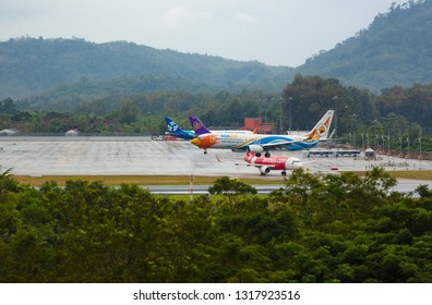 PHUKET, THAILAND - NOVEMBER 30, 2016: Boeing 737-88L, HS-DBW of Nokair Comes to land in the rain at Phuket International Airport