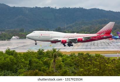 PHUKET, THAILAND - NOVEMBER 30, 2016: Boeing 747-446, EI-XLH of Rossiya landing in the rain at Phuket International Airport