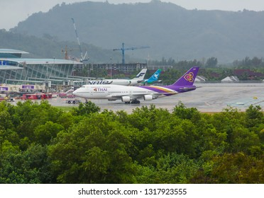 PHUKET, THAILAND - NOVEMBER 30, 2016: Boeing 747-4D7, HS-TGA of Thai Airways taxis on the runway at Phuket airport