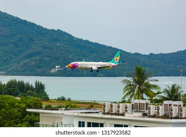 PHUKET, THAILAND - NOVEMBER 30, 2016: Boeing 737-86J, HS-DBQ of Nok Air (10th Anniversary Livery) is landing and approach from the sea at Phuket International Airport
