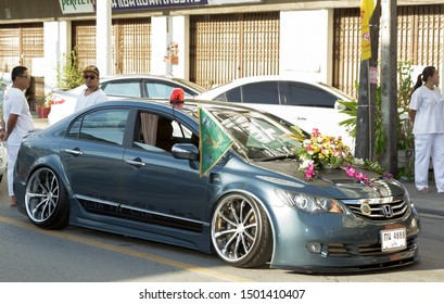 Phuket, Thailand - Oct 2016: Tuned car (truck) with loud music and subwoofers on Phuket Veg Fest. Low car on very large chrome wheels on a street procession during the Festival of Nine Emperor God