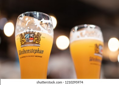 PHUKET, THAILAND - OCT 22, 2018: glass of weihenstephaner beer with beautiful light bokeh, weihenstephaner is one of favorite german beer, company slogan is the world's oldest brewery
