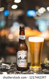 PHUKET, THAILAND - OCT 29, 2018: asahi beer label on bottle and chill glass with light bokeh, asahi is one of favorite japan beer
