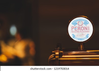 PHUKET, THAILAND - OCT 29, 2018: peroni logo on copper dispenser with beautiful light bokeh, peroni is number one lager brand in Italy