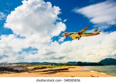 Phuket, Thailand - October 15, 2015 : Bangkok airways airline Airbus 320 Landing at Phuket Airport From Ocean side in sunny day