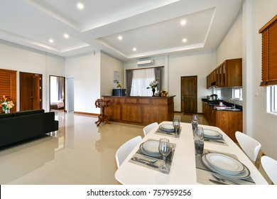 PHUKET, THAILAND - OCTOBER 22 : Beautiful Modern dining room interior with kitchen zone at the home for a new family on OCTOBER 22, 2017, in Phuket Thailand.