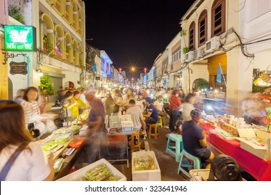 Phuket, Thailand - October 4, 2015: Unidentified tourists are shopping at old town night market (Walking street) in Phuket, Thailand.