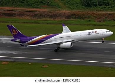PHUKET, THAILAND - OCTOBER 7,2009: Thai Airways Airbus A330-300 reg. HS-TEP Taking off runway 09 at Phuket Int'l Airport direct to Suvarnabhumi (Bangkok) Airport